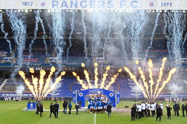 Fireworks accompany Rangers' title celebrations at Ibrox as James Tavernier lifts the Premiership trophy aloft among his team-mates. (Photo by Rob Casey / SNS Group)