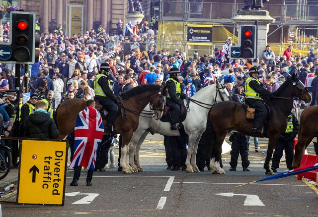 Five police officers were injured and 28 people were arrested amidst the disorder in Glasgow's George Square. Picture: Lisa Ferguson        Rangers fans gather at George Square this afternoon after Rangers lift The SPFL Premier League Cup on the last day of the season
