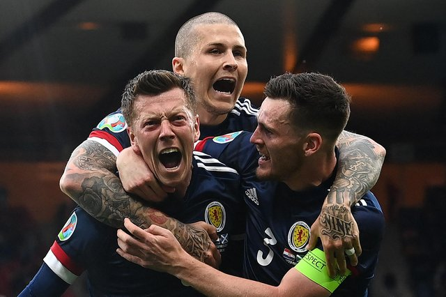 Callum McGregor celebrates his Scotland strike with Andy Robertson and Lyndon Dykes, but Croatia claimed a 3-1 win to progress to the Euro 2020 last 16. (Photo by PAUL ELLIS/POOL/AFP via Getty Images)