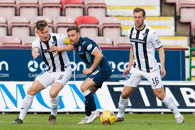 Raith's Lewis Vaughan (centre) is challenged by Euan Murray of Dunfermline.