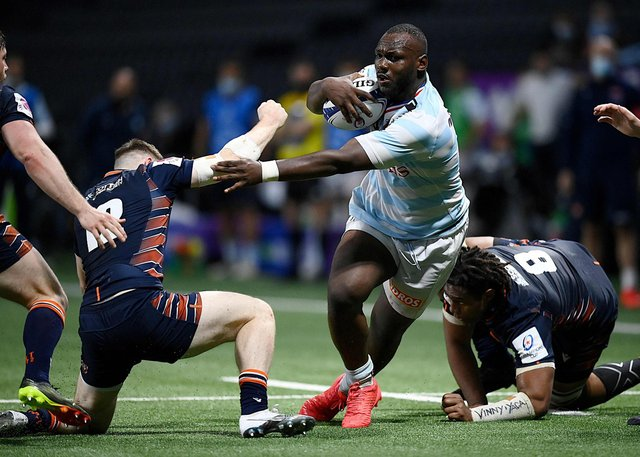 Edinburgh's  centre George Taylor (L) fights for the ball with Racing92's French flanker Jordan Joseph (C) during the match  at the U Arena in Nanterre, near Paris on April 4, 2021. (Photo by FRANCK FIFE/AFP via Getty Images)