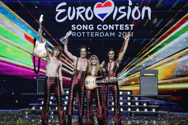 Italy's Maneskin pose for pictures on stage with the trophy after winning the final of the 65th edition of the Eurovision Song Contest 2021, at the Ahoy convention centre in Rotterdam