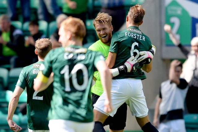 Hibernian goalkeeper Mark Oxley (left) celebrates his goal with team-mate Jordan Forster.