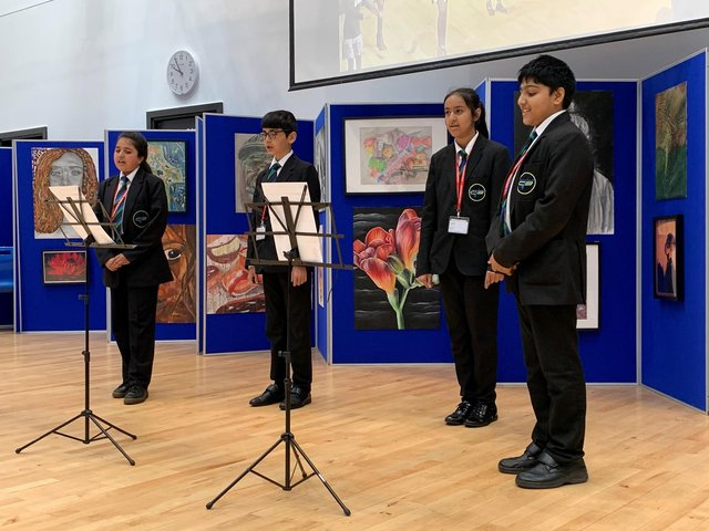A group of Year 7 students, singing the One Britain One Nation Day song in the school hall at Carlton Bolling College in West Yorkshire