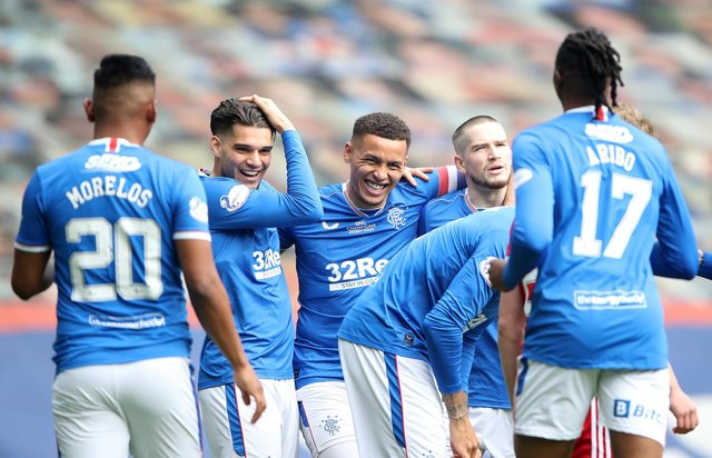 James Tavernier (L) of Rangers celebrates their team's first goal with teammates, an own goal scored by Joe Lewis of Aberdeen.  (Photo by Ian MacNicol/Getty Images)