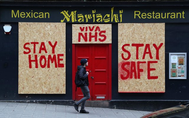 A boarded-up restaurant in Edinburgh has been painted with a message supporting the NHS as the lockdown continues (Picture: Andrew Milligan/PA Wire)
