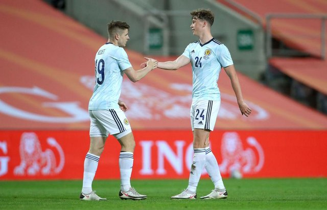Jack Hendry, right, congratulates Kevin Nisbet after the latter's goal for Scotland against the Netherlands on Wednesday night. Picture: Getty