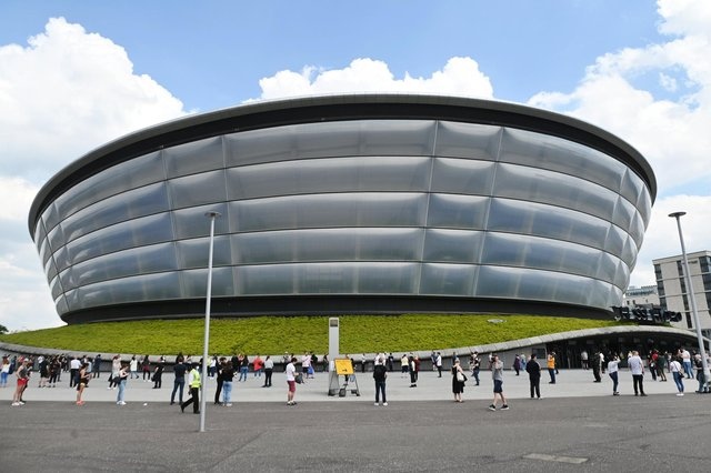 People wait for a Covid vaccine appointment at the SSE Hydro earlier in June. Picture: John Devlin