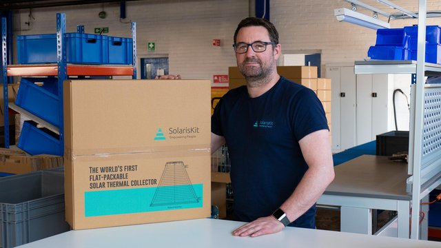Service and installation manager Kris Aitchison with a packaged SolarisKit collector. Picture: contributed.