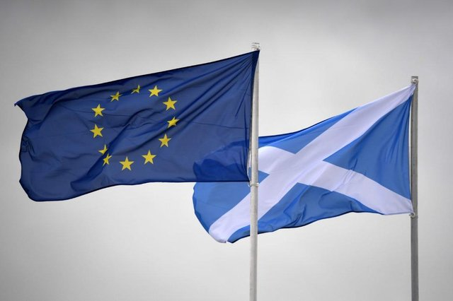 """The EU flag and Saltire flutter side by side. All of the """"New Scots"""" interviewed by Barbara Henderson originally came from the EU PIC: Getty Images"""