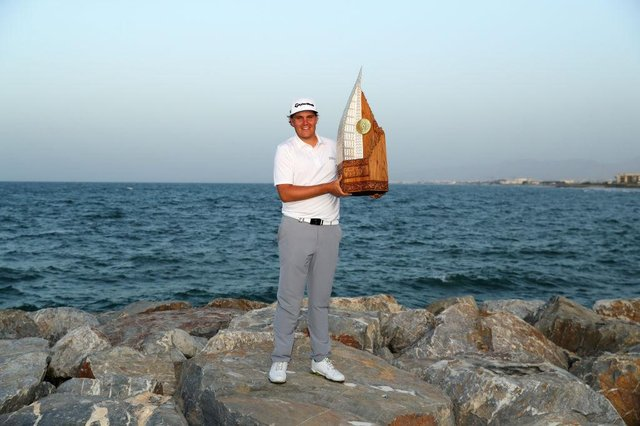 Sami Valimaki of Finland poses with the trophy after winning the 2020 Oman Open at Al Mouj Golf in Muscat. Picture: Warren Little/Getty Images.