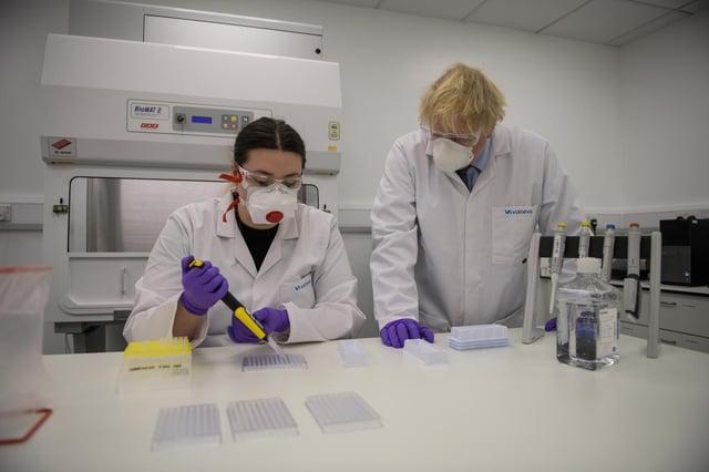 Prime Minister Boris Johnson with quality control technician Kerri Symington on a visit to the Livingston Valneva site in January.
