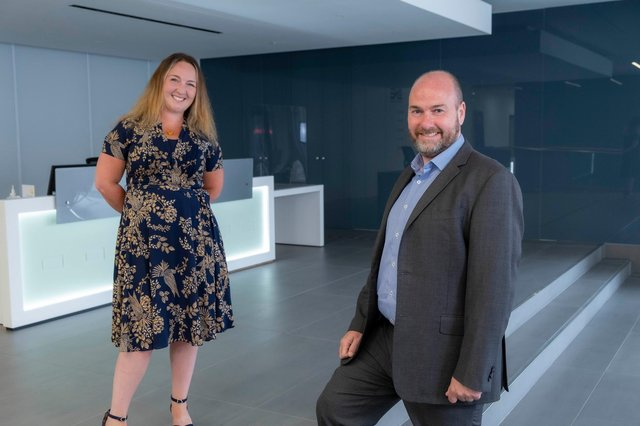 AAB's acquisition of Purpose HR is announced by Lisa Thomson, CEO, at Purpose HR, and Graeme Allan, chief executive at AAB. Picture: Peter Devlin