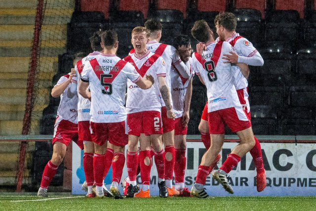 Airdrie's Calum Gallagher (centre) is mobbed by his teammates after scoring the winner against Cove Rangers