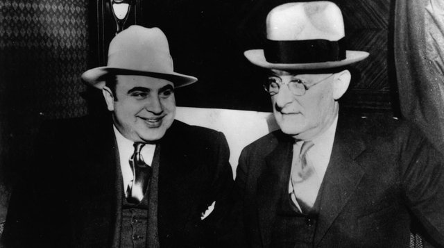 Infamous American gangster Al Capone with US Marshall Laubenheimar (Getty Images)