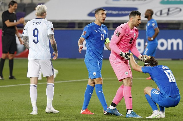 Players react to the draw at the end of the 2022 FIFA World Cup qualifier group F football match between Israel and Scotland at Bloomfield stadium in the Israeli Mediterranean coastal city of Tel Aviv on March 28, 2021. (Photo by JACK GUEZ / AFP) (Photo by JACK GUEZ/AFP via Getty Images)
