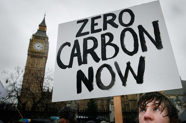 A climate change protestor calls for action on climate change, but carbon dioxide is not the only gas we need to worry about. Methane also plays a significant role.  (Picture: Peter Macdiarmid/Getty Images)