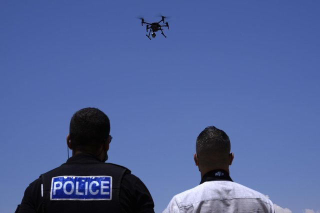 The use of drones and other forms of technology to monitor the public raise serious questions about human rights (Picture: Petros Karadjias/AP)