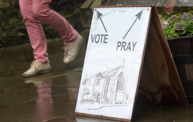 Voters would be required to show photographic identification if new laws are passed (Picture: Lesley Martin/AFP via Getty Images)