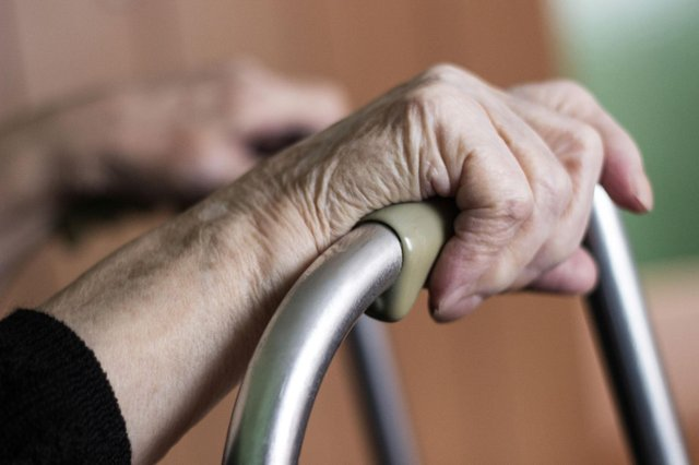 An older person holding onto their walking frame. Picture: PA