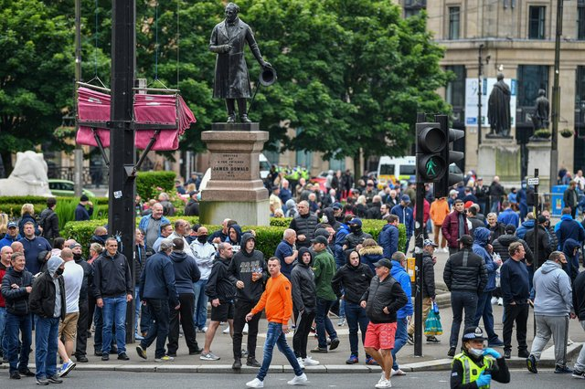 A large number of people gathered in George Square, Glasgow. The Loyalist Defence League earlier asked followers to gather over the weekend for a 'protect the Cenotaph' event in response to statues being defaced across Scotland following Black Lives Matter demonstrations. (Photo by Jeff J Mitchell/Getty Images)