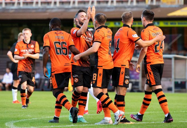 Dundee United's players celebrate after Peter Pawlett put them 4-1 up. Picture: SNS