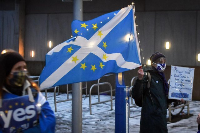 Anti-Brexit, pro-Scottish independence activists hold a small protest against the UK's exit from the European Union outside the Scottish Parliament on December 31, hours before the end of the transition period (Picture: Andy Buchanan/AFP via Getty Images)
