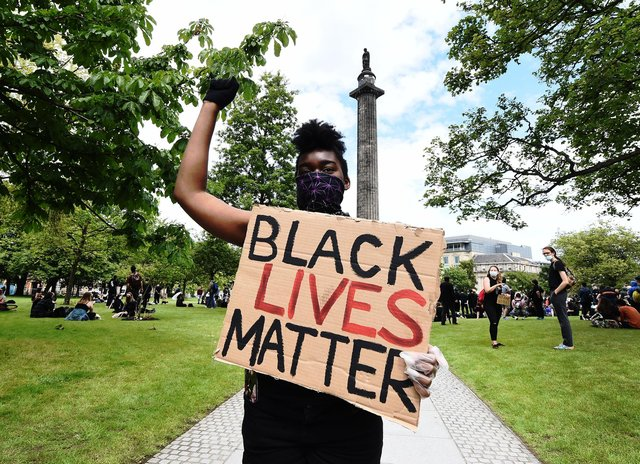 A Black Lives Matter protest at Melville Monument in Edinburgh. Should black history be included in the school curriculum?