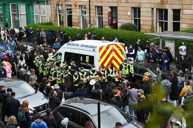 Kenmure Street: Glasgow residents and activists protest chanting ' deportations no more' in standoff with Home Office's UK Border Agency allegedly attempting to deport neighbours | The Scotsman