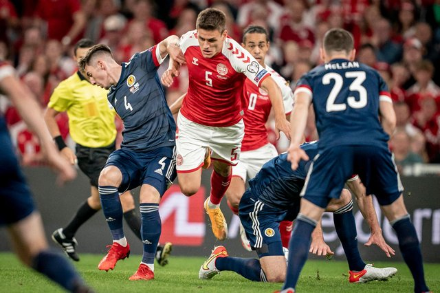Billy Gilmour (left) tussles with Denmark's Joakim Mahle on a difficult night for Scotland in Copenhagen. (Photo by MADS CLAUS RASMUSSEN/Ritzau Scanpix/AFP via Getty Images)