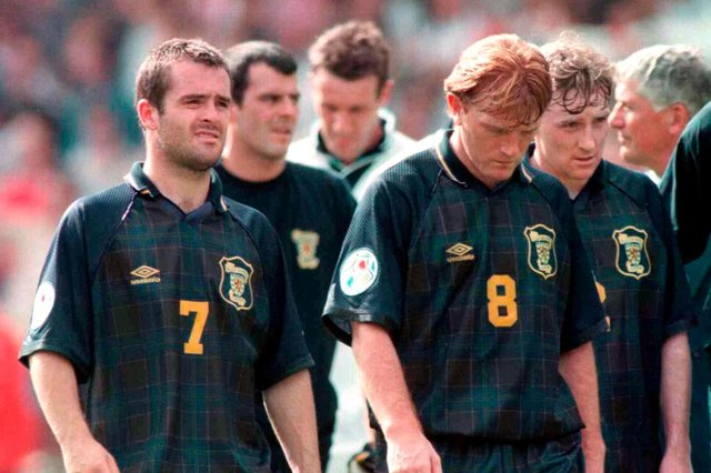 Dejection for John Spencer, Stuart McCall, and Stewart McKimmie after defeat at Wembley in Euro 96