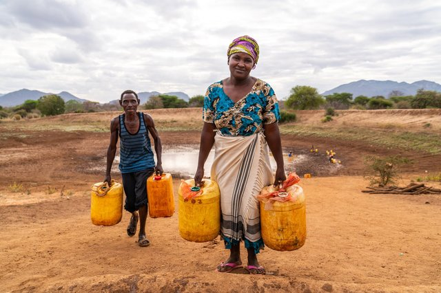 Justine lives with her husband and five children near the Kalikuvu earth dam in Kitui, south Kenya, where communities vulnerable to the impact of climate change are struggling with prolonged periods of drought and erratic heavy rainfall. Picture by Adam Finch