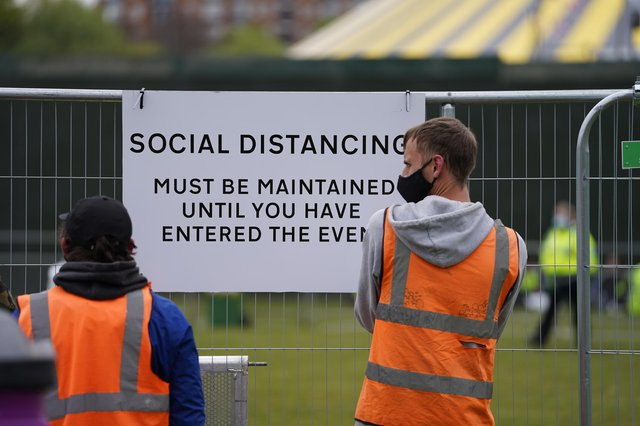 Signage being put up at a music festival in Sefton Park in Liverpool as part of the national Events Research Programme (ERP). Picture date: Sunday May 2, 2021.