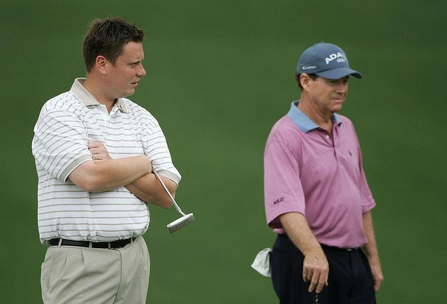 Stuart Wilson waits with Tom Watson on the first green during the second round  of the 2005 Masters at Augusta National Golf Club. Picture: Andrew Redington/Getty Images.
