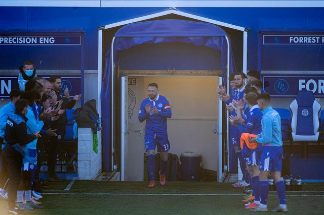 Queen of the South skipper Stephen Dobbie is given a guard of honour by his teammates and backroom staff before the 2-0 defeat to Dundee  (Photo by Craig Foy / SNS Group)