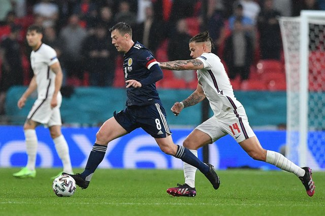 Scotland midfielder Callum McGregor holds off England's Kalvin Phillips during the Euro 2020 clash at Wembley. (Photo by JUSTIN TALLIS/POOL/AFP via Getty Images)