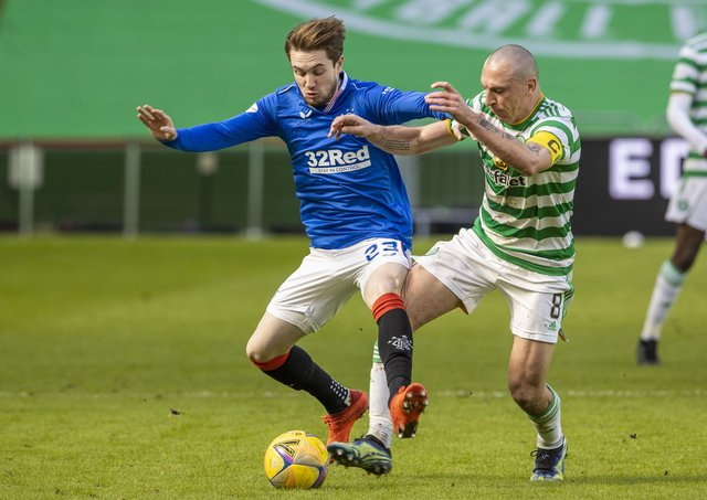 Rangers' Scott Wright (left) and Celtic's Scott Brown battle for possession during the Scottish Premiership match between Celtic and Rangers at Celtic Park, on March 21, 2021, in Glasgow, Scotland. (Photo by Alan Harvey / SNS Group)