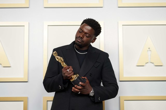 Daniel Kaluuya poses backstage with the Oscar for Best Actor in a Supporting Role, for Judas And The Black Messiah, at the 93rd Academy Awards ceremony.