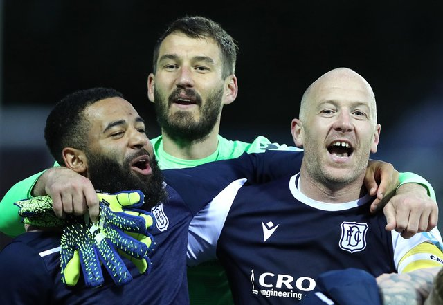 Dundee midfield lynchpin Charlie Adam (r) celebrates with team mates after the Scottish Premiership Playoff Final 2nd Leg between Kilmarnock and Dundee at Rugby Park on May 24, 2021 in Kilmarnock, Scotland. (Photo by Ian MacNicol/Getty Images)