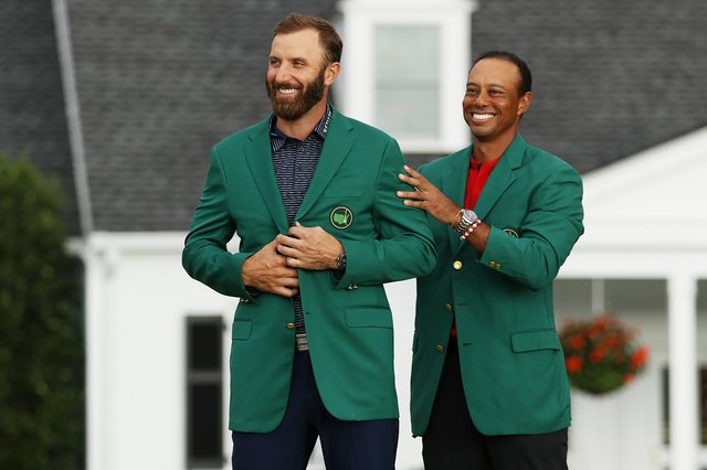 Tiger Woods, who presented Dustin Johnson with the Green Jacket in 2020, will miss the 2021 Masters through injuries sustained in a car crash in California on 23 February. (Pic: Getty Images)