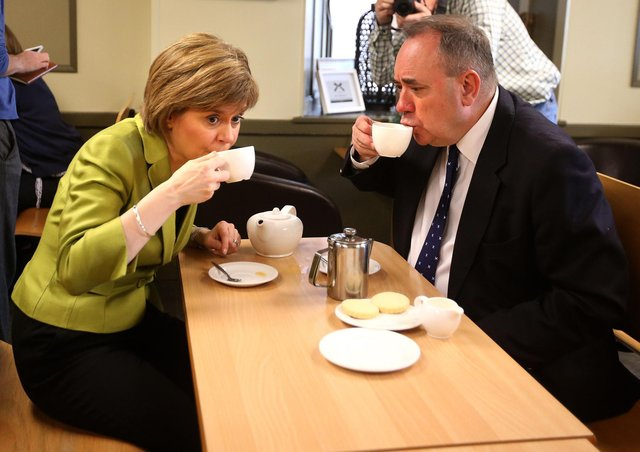 Current First Minister Nicola Sturgeon enjoys a cup of tea with her predecessor Alex Salmond while on the general election campaign trail in 2015