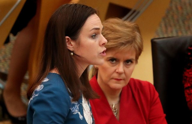 Finance Secretary Kate Forbes, seen with watched by Nicola Sturgeon, has offered councils money if they will agree to freeze council tax (Picture: Andrew Milligan/PA)