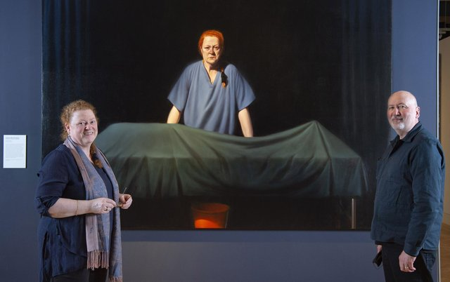 Professor Dame Sue Black and artist Ken Currie in front of Currie's new portrait, Unknown Man (2019), of which Professor Black is the subject.