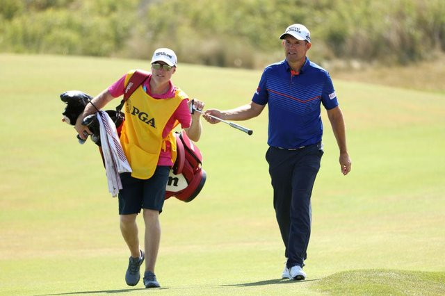 Padraig Harrington hands a club to caddie Ronan Flood during the final round of the 2021 PGA Championship at Kiawah Island. Picture: Jamie Squire/Getty Images.
