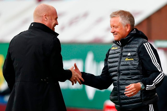 Chris Wilder, right, has been tipped to succeed Sean Dyche at Burnley if the Clarets boss is tempted south to Crystal Palace