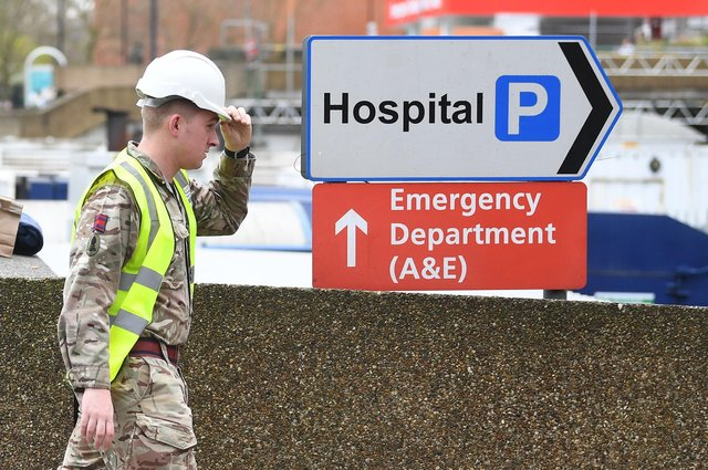 Military personnel outside St Thomas' Hospital, in central London, as the UK continues in lockdown to help curb the spread of the coronavirus