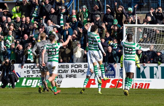 Celtic players celebrate in front of the away fans at Dens Park in 2019. Picture: SNS