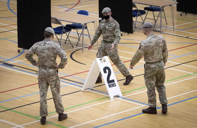 Members of the Royal Scots Dragoon Guard carry out a reconnaissance before setting up a Covid–19 vaccination centre at the Ravenscraig Regional Sports Facility in Motherwell
