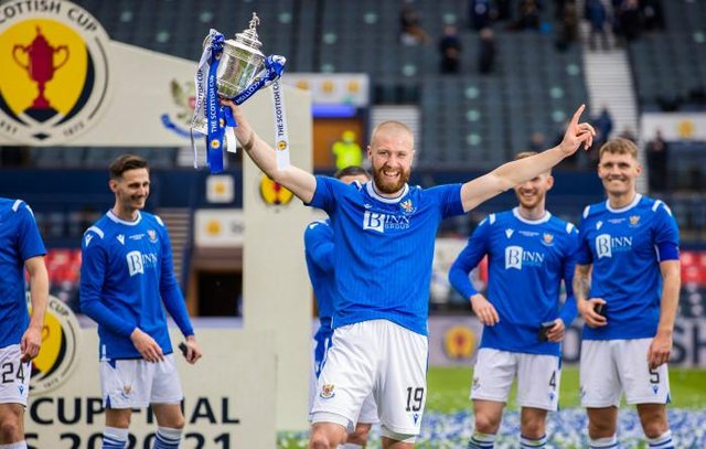 St Johnstone's Shaun Rooney  lifts the Scottish Cup trophy after scoring the winner at Hampden. (Photo by Craig Williamson / SNS Group)