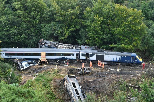 Three people died when this train derailed near Stonehaven after debris was washed on to the tracks amid heavy rain (Picture: John Devlin)